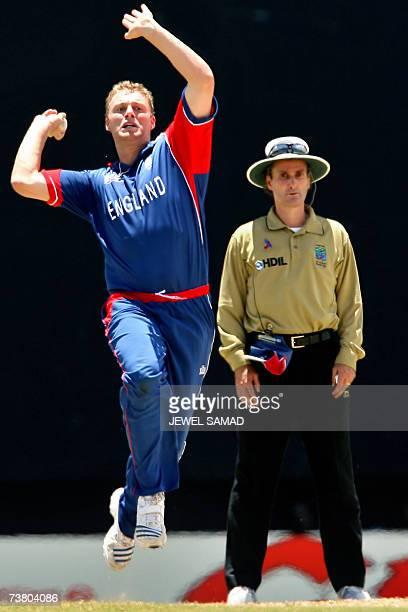 St John's ANTIGUA AND BARBUDA Englands's cricketer Andrew Flintoff delivers a ball to Sri Lankan cricket team captain Mahela Jayawardene during the...