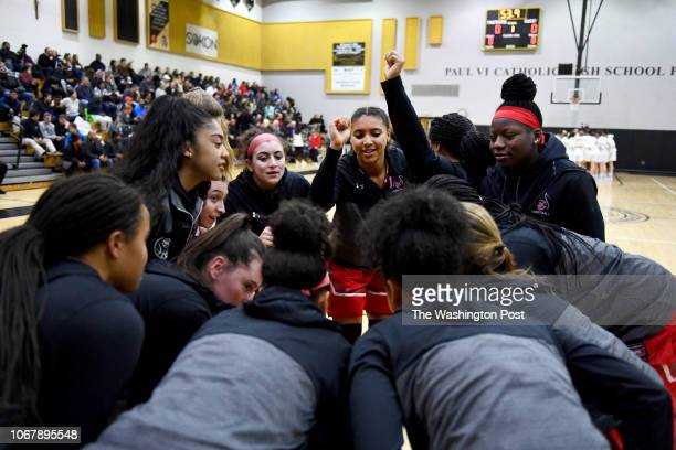 St John's Cadets Azzi Fudd center and the rest of the team huddle before the game against the Paul VI Panthers January 03 2018 in Fairfax VA