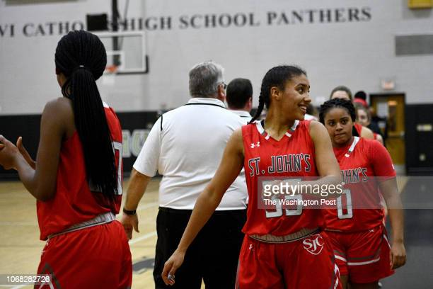 St John's Cadets Azzi Fudd reacts to congratulations after the game against the Paul VI Panthers that she helped seal 5145 with free throws January...