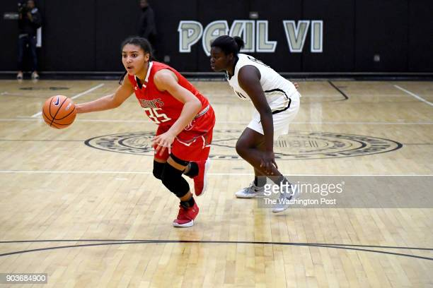 St John's Cadets Azzi Fudd sets up the play with Paul VI Panthers guard Ashley Owusu in pursuit in the first half January 03 2018