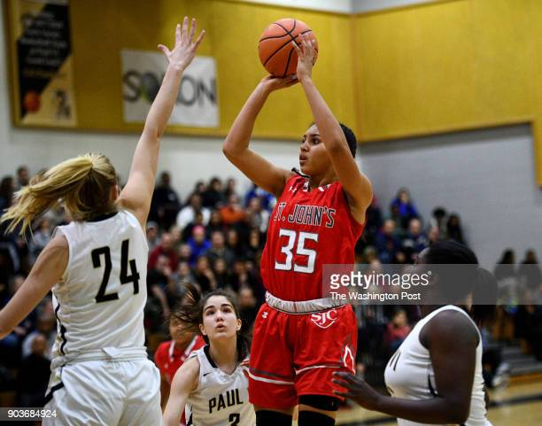 St John's Cadets Azzi Fudd shoots over Paul VI Panthers guard Kate Klimkiewicz in the first half January 03 2018 in Fairfax VA Fudd scored 27 points...
