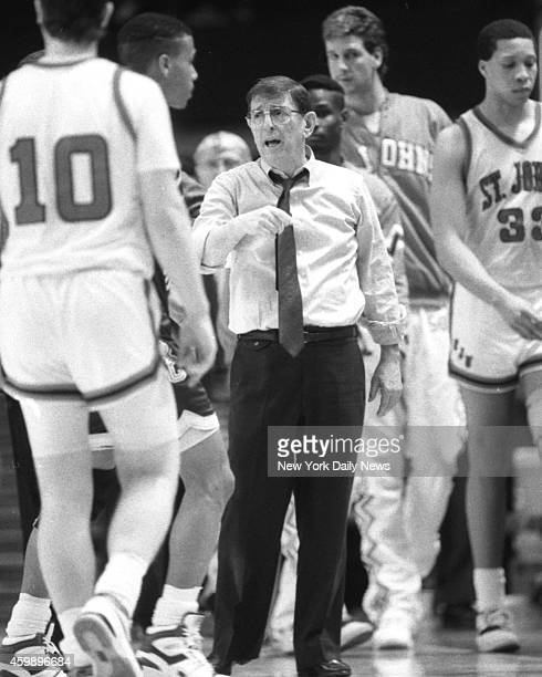 St. John's coach Lou Carnesecca tries to rally troops in Big East Tournament's 8-9 game vs. Boston College last night at Garden. But Dana Barros...