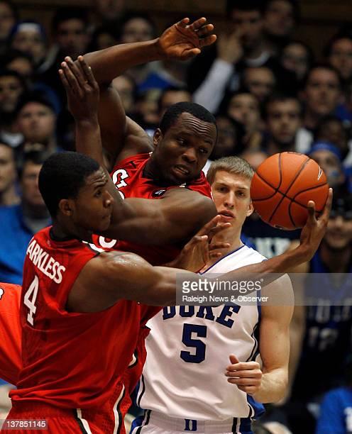 St. John's forward Moe Harkless and forward God'sgift Achiuwa grab a rebound as Duke forward Mason Plumlee looks on during game action at Cameron...
