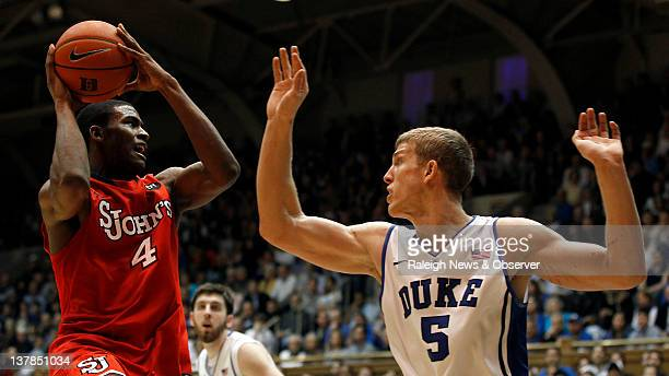 St. John's forward Moe Harkless looks for help as Duke forward Mason Plumlee defends during the second half at Cameron Indoor Stadium in Durham,...