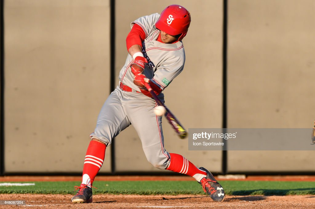 St. John's outfielder Michael Donadio (7) gets a hit in a game between the St. John's Red Storm and the East Carolina Pirates during the Keith LeClair Classic on March 4, 2017 at Clark-LeClair Stadium in Greenville, NC. East Carolina defeated St. John's 7 - 4.
