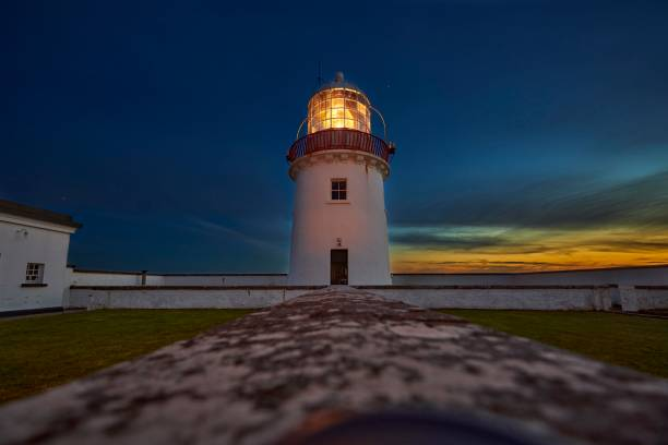 St. Johns Point lighthouse at dusk, with luminous light on, St. Johns Point, County Donegal, Ireland