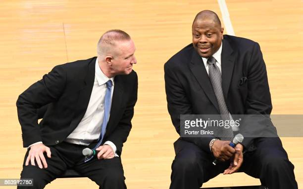 St John's Red Storm coach Chris Mullin left listens to Georgetown Hoyas coach Patrick Ewing during the Big East Conference basketball media day at...