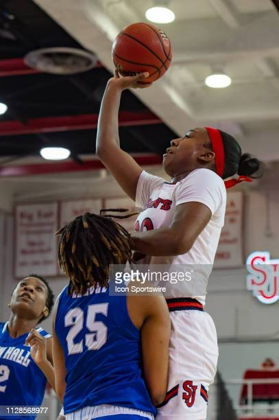 St John's Red Storm forward Akina Wellere shoots the ball during the second half of the women's college basketball game between the Seton Hall...