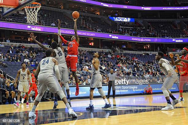 St John's Red Storm forward Kassoum Yakwe scores in the first half against Georgetown Hoyas center Jessie Govan on January 9 at the Verizon Center in...