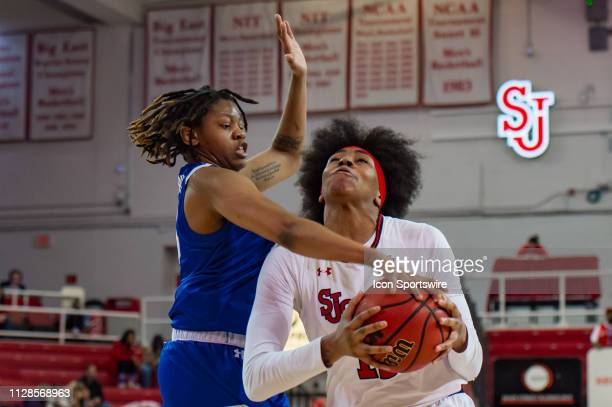 St John's Red Storm forward Kayla Charles drives to the basket during the second half of the women's college basketball game between the Seton Hall...