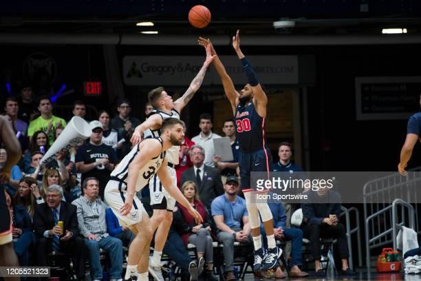 St. John's Red Storm forward LJ Figueroa shoots over Butler Bulldogs forward SeanMcDermott during the men's college basketball game between the St...