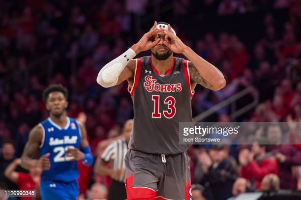 St John's Red Storm forward Marvin Clark II celebrates after hitting a three point basket during the second half of the college basketball game...