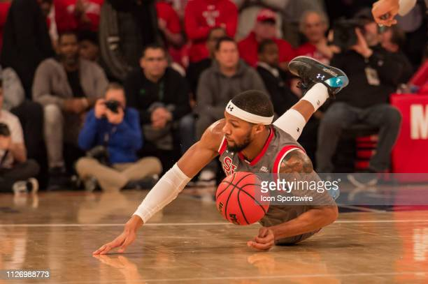 St John's Red Storm forward Marvin Clark II dives for loose ball during the first half of the college basketball game between the Seton Hall Pirates...