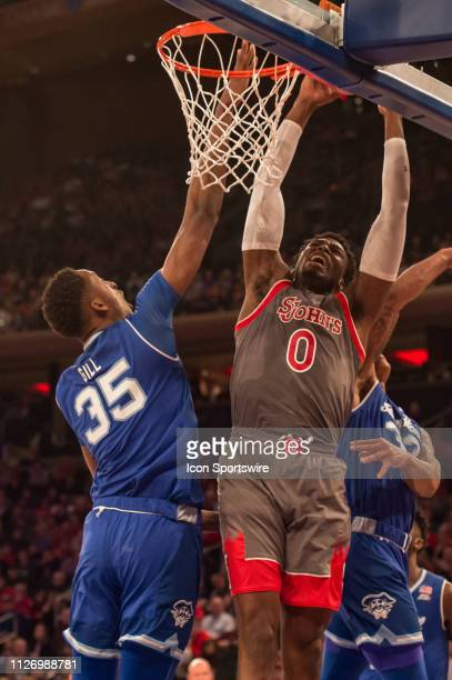 St John's Red Storm forward Sedee Keita is fouled by Seton Hall Pirates center Romaro Gill during the first half of the college basketball game...