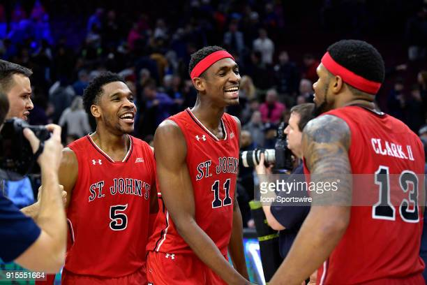 St John's Red Storm forward Tariq Owens and St John's Red Storm guard Justin Simon and St John's Red Storm forward Marvin Clark II congratulate each...