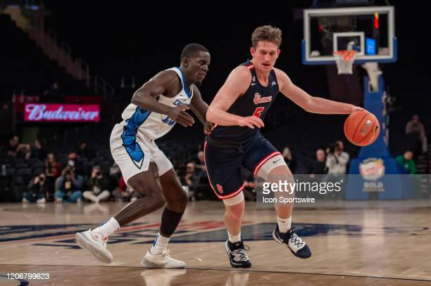 St John's Red Storm guard David Caraher drives to the basket during the first half of the Big East tournament quarterfinal round game between the St...