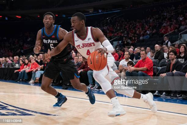 St John's Red Storm Guard Greg Williams Jr dribbles the ball along the baseline with DePaul Blue Demons Guard Jalen ColemanLands defending during the...