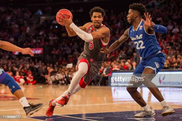 St John's Red Storm guard Justin Simon drives to the basket during the first half of the college basketball game between the Seton Hall Pirates and...