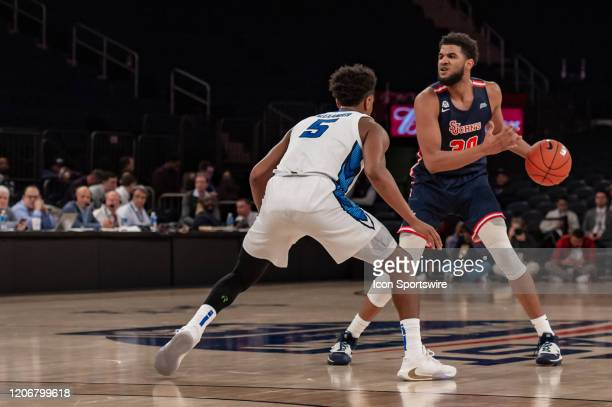 St John's Red Storm guard LJ Figueroa looks for an opening during the first half of the Big East tournament quarterfinal round game between the St...