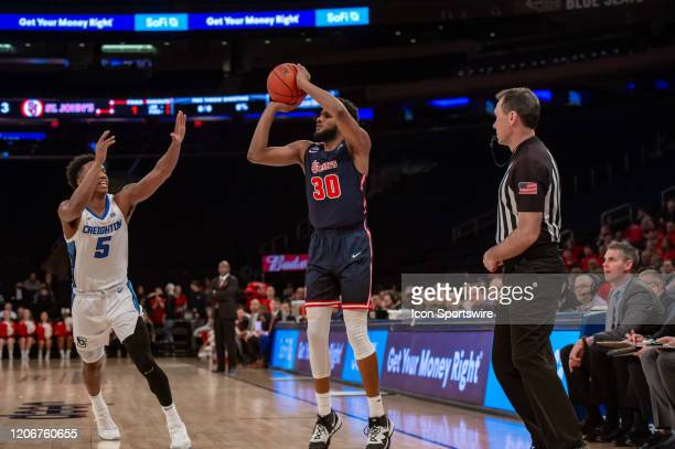 St John's Red Storm guard LJ Figueroa shoots the ball during the first half of the Big East tournament quarterfinal round game between the St Johns...