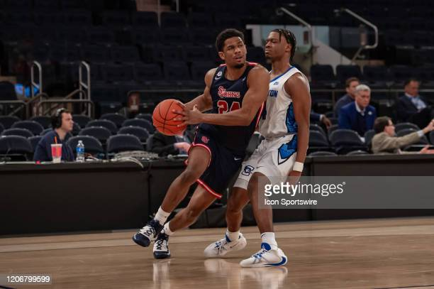 St John's Red Storm guard Nick Rutherford drives to the basket during the first half of the Big East tournament quarterfinal round game between the...