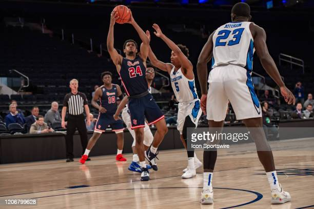 St John's Red Storm guard Nick Rutherford shoots the ball during the first half of the Big East tournament quarterfinal round game between the St...