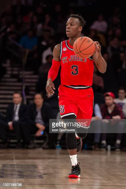 St. John's Red Storm guard Rasheem Dunn handles the ball during the Big East tournament first round game between the St. Johns Red Storm and...