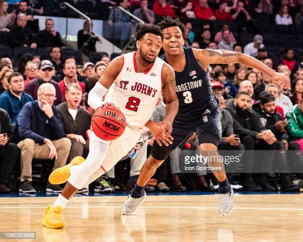St John's Red Storm Guard Shamorie Ponds dribbles the ball past Georgetown Hoyas Guard James Akinjo defending during the first half of the Georgetown...