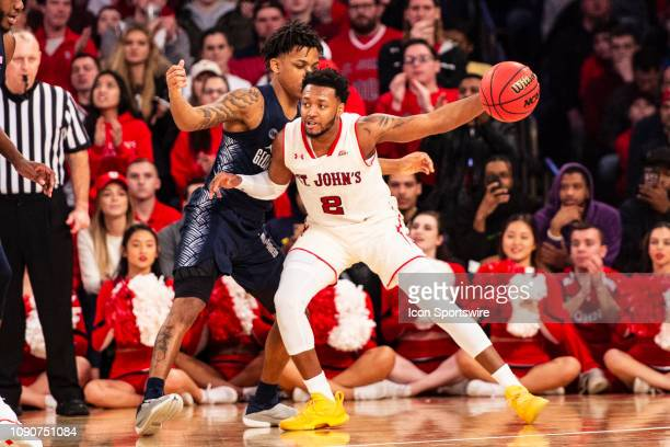 St John's Red Storm Guard Shamorie Ponds looks to make a move with Georgetown Hoyas Guard James Akinjo defending during the second half of the...