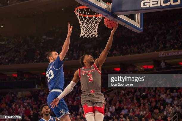 St John's Red Storm guard Shamorie Ponds scores a basket during the first half of the college basketball game between the Seton Hall Pirates and the...