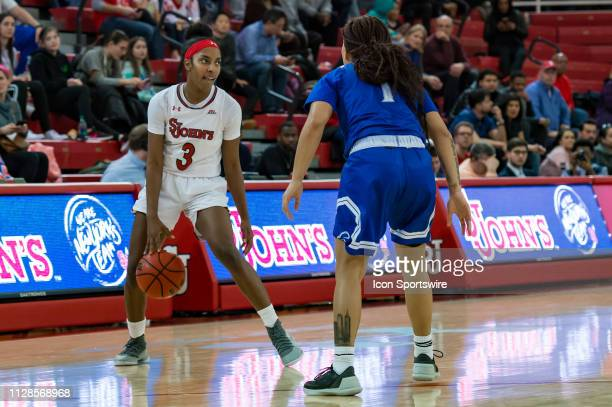St John's Red Storm guard Tiana England sets the play during the second half of the women's college basketball game between the Seton Hall Pirates...
