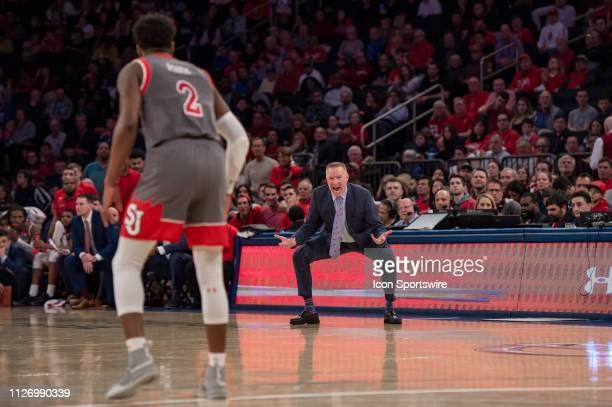 St John's Red Storm head coach Chris Mullin yells instructions to guard Shamorie Ponds during the second half of the college basketball game between...