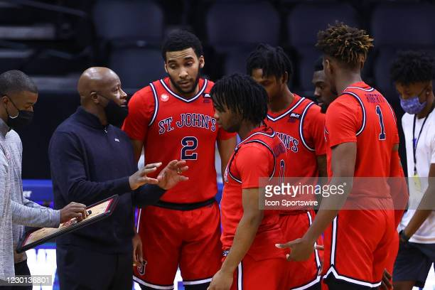St. John's Red Storm head coach Mike Anderson talks with his players prior to the college basketball game between the Seton Hall Pirates and the St....