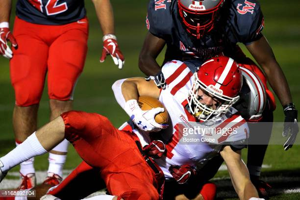 St. John's wide receiver Jay Brunelle is tackled for a loss during the first half. Catholic Memorial High School hosts St. John's High School of...