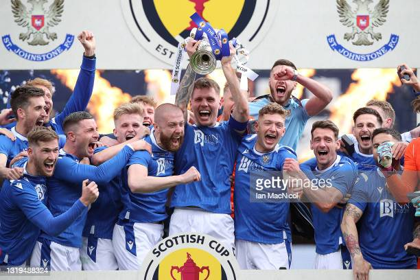 St Johnstone captain Jason Kerr holds the trophy after his team defeat Hibernian 1-0 during the Scottish Cup Final between St Johnstone and Hibernian...
