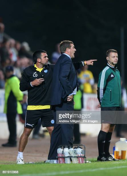 St Johnstone Manager Tommy Wright stands as assistant Callum Davidson gestures on the touchline