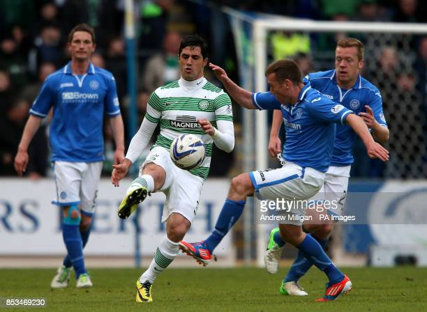 St Johnstone's Paddy Cregg challenges Celtics Beram Kayal during the Scottish Premiership match at McDiarmid Park Perth