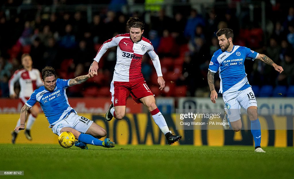 St Johnstone's Paul Paton and Rangers Josh Windass compete for the ball during the Ladbrokes Scottish Premiership match at McDiarmid Park, Perth.