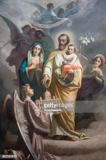 st. joseph and his sacred family - holy family jesus mary and joseph stock photos and pictures