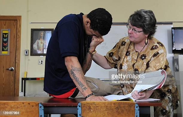February 3: St. Joseph Central Catholic High School math teacher Candy Kmen, right, works with Huntington Prep senior guard Negus Webster-Chan during...