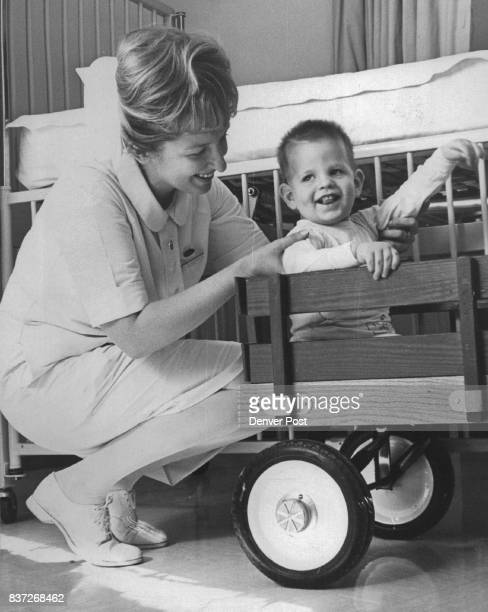 St Joseph Hospital Red Wagon Children who are patients at St Joseph Hospital ride a little red wagon when they are taken from their rooms to...