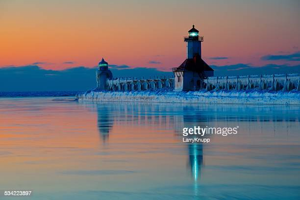 St. Joseph North Pier Light at sunset in January with snow and ice