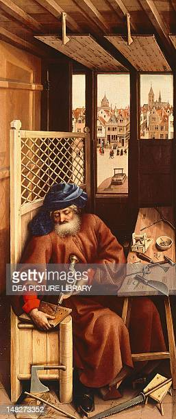 St Joseph the carpenter right panel of the Annunciation of Merode Triptych ca 1425 by the Master of Flemalle oil on panel 645x28 cm New York The...