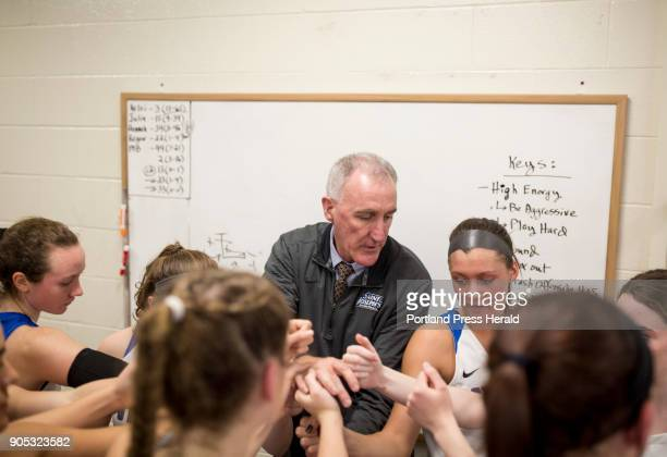 St Joseph's College girls basketball head coach Mike McDevitt and his team come together before the start of the second half their game against...