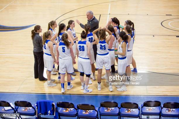 St Joseph's College girls basketball head coach Mike McDevitt talks to his team during a time out in the second half of their game against Johnson...