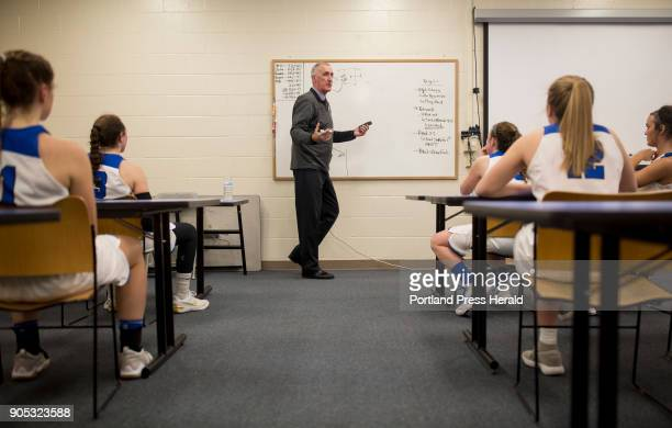 St Joseph's College girls basketball head coach Mike McDevitt talks to his team about the plan for the second half of their game against Johnson...