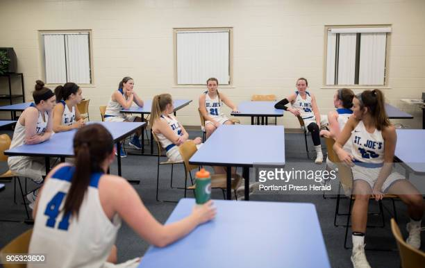 St Joseph's College girls basketball team talk about their plan for the second half of their game against Johnson Wales University in a classroom...