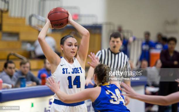 St Joseph's College junior Julia Champagne looks for a teammate to pass to during their game against Johnson Wales University on Tuesday night The...