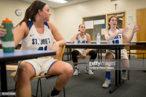 St Joseph's College junior Kelsi McNamara right talks to her team about their plan for the second half of their game against Johnson Wales University...