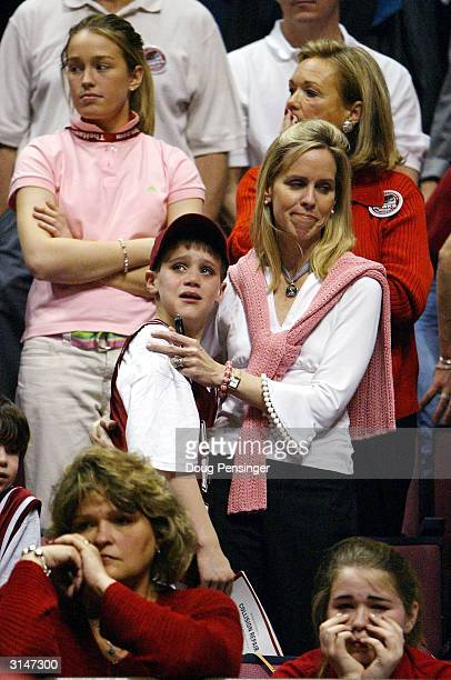 St Joseph's Hawks fans react after losing 6462 to the Oklahoma State Cowboys during their fourth round regional game of the NCAA Division I Men's...